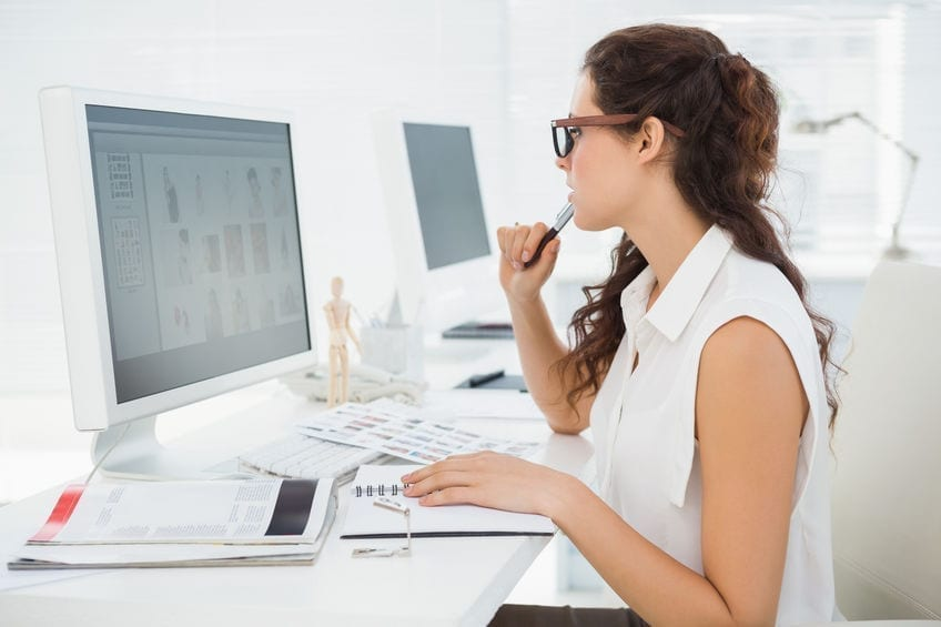 Concentrated businesswoman using computer monitor in the office